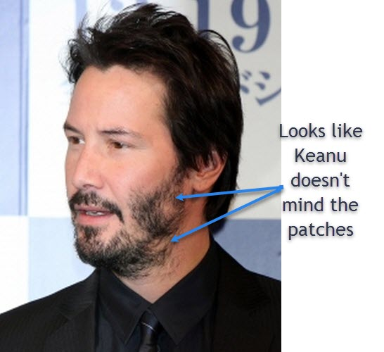 Keanu Reeves has some patches in his beard. He still looks good
