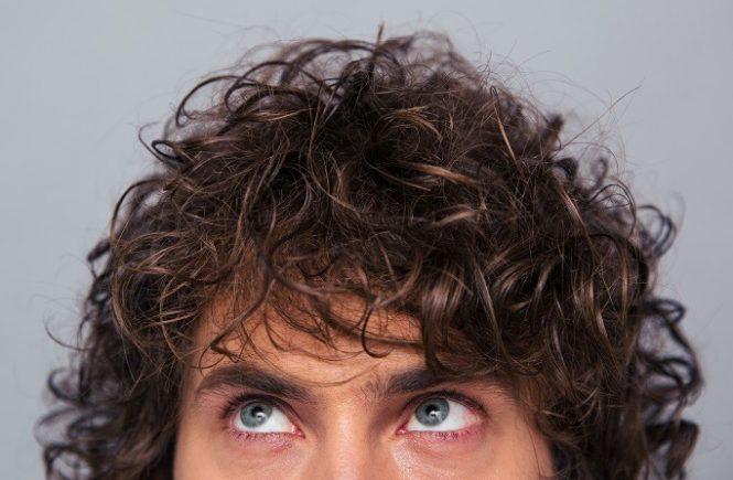 curly haired man